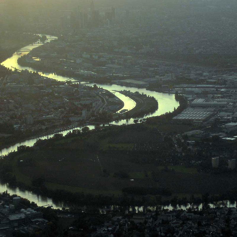 aerial view of a river through a city in Western Europe