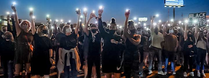 Protesters light up their cell phones on September 24, 2020 in St Louis, Missouri, at a demonstration after a grand jury's decision related to charges in the death of Breonna Taylor.