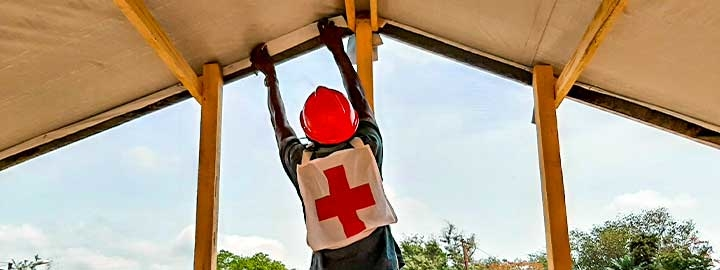 Central African Red Cross Society volunteers construct an isolation unit for people who have suspected cases of COVID--19.