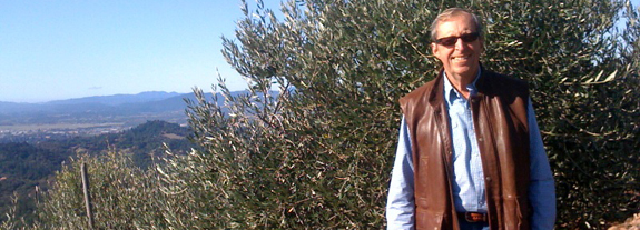 Burt Fohrman in his olive orchard
