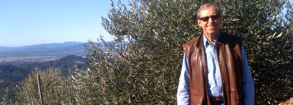Burt Fohrman in his olive orchard